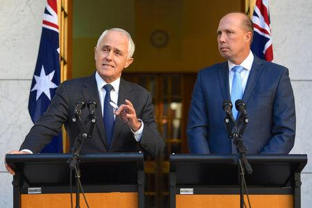 Australia's Prime Minister Malcolm Turnbull speaks as Immigration Minister Peter Dutton listens on during a media conference at Parliament House in Canberra, Australia