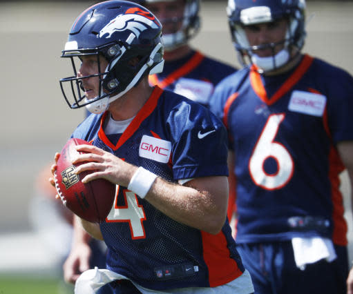 Denver Broncos quarterback Case Keenum takes part in a drill during an NFL football minicamp session Tuesday, May 22, 2018, at the team's headquarters in Englewood, Colo.(AP Photo/David Zalubowski)