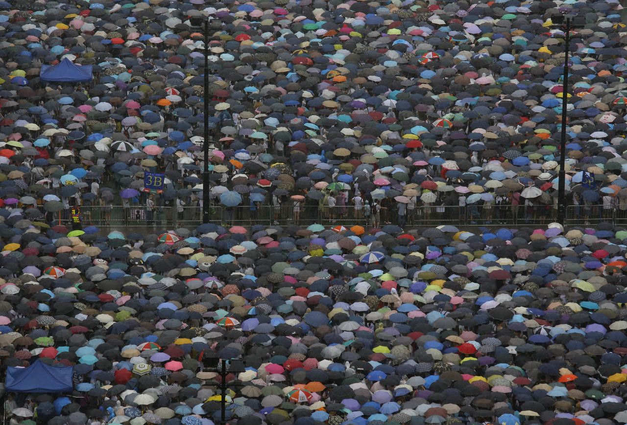 Tens of thousands of Hong Kong residents gather at Victoria Park before an annual pro-democracy protest in Hong Kong Monday, July 1, 2013. The protesters demanded their widely disliked Beijing-backed leader resign and pressing for promised democratic reforms so they can choose their own top representative. The march is an annual event that underscores the growing gulf between Hong Kong and the mainland 16 years after the city ceased to be a British colony and came back under Beijing's control. (AP Photo/Vincent Yu)