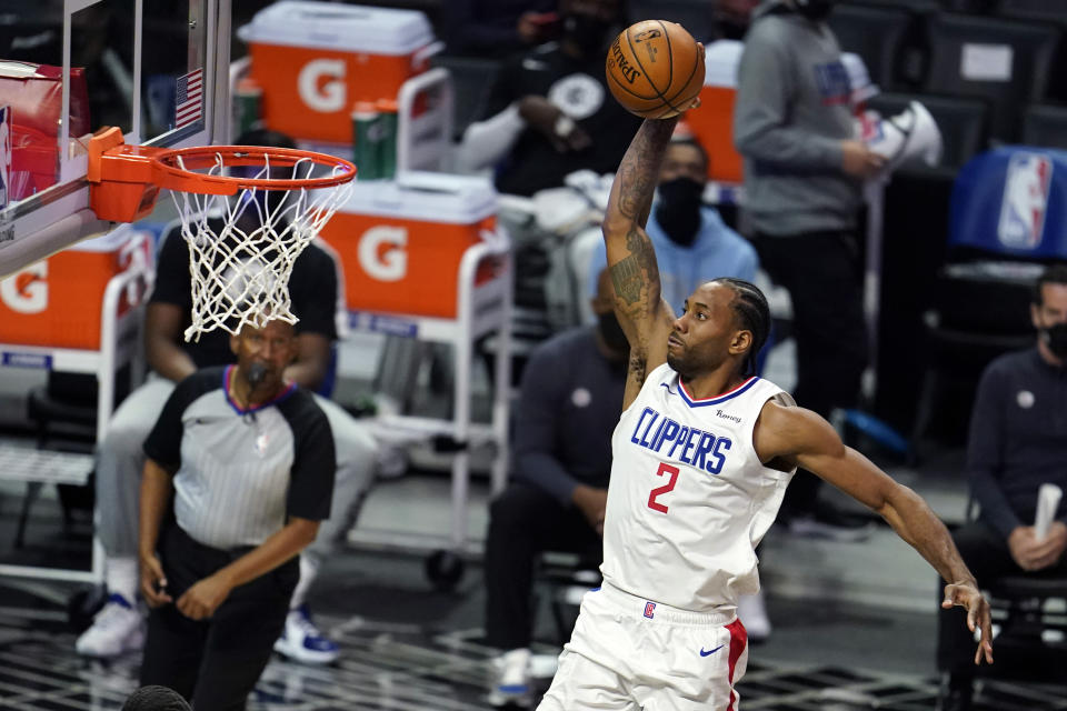 Los Angeles Clippers forward Kawhi Leonard (2) dunks against the Toronto Raptors during the first half of an NBA basketball game Tuesday, May 4, 2021, in Los Angeles. (AP Photo/Marcio Jose Sanchez)