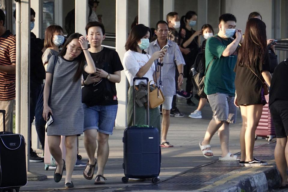 People arriving at Woodlands Checkpoint on 17 March, 2020. (PHOTO: Dhany Osman/Yahoo News Singapore)