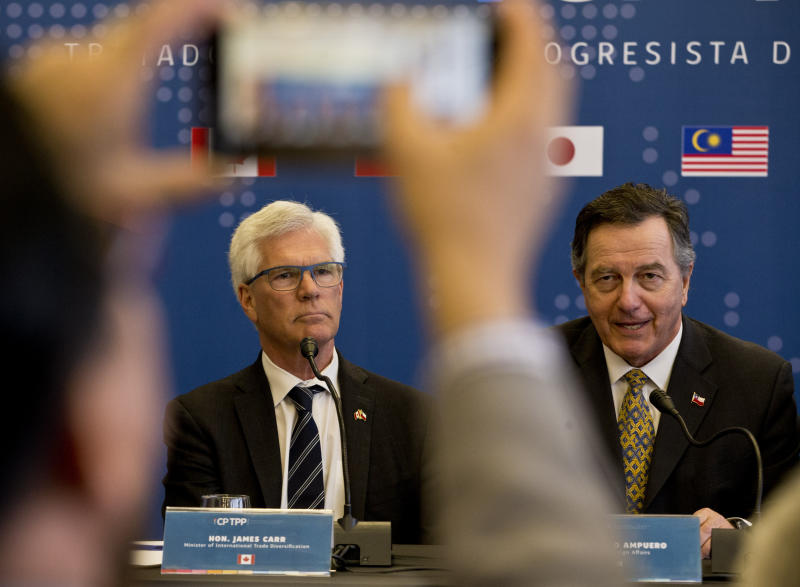 Chilean Foreign Minister Fernando Ampuero, talks next to James Carr, Minister of International Trade Diversification of Canada during a meeting of the Comprehensive and Progressive Agreement for Trans-Pacific Partnership, CP TPP, in Santiago, Chile, Thursday, May 16, 2019. (AP Photo/Esteban Felix)