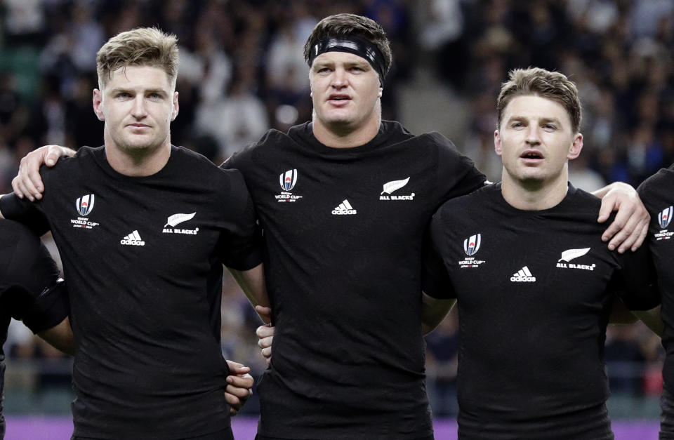 Barrett brother's from left, Jordie, Scott and Beauden sing the national anthem prior to the start of the Rugby World Cup Pool B game at Oita Stadium between New Zealand and Canada in Oita, Japan, Wednesday, Oct. 2, 2019. (AP Photo/Aaron Favila)