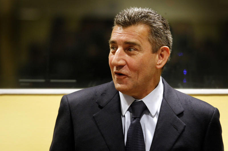 Former Croatian Army General Ante Gotovina enters the courtroom of the Yugoslav war crimes tribunal (ICTY) for his appeal judgement in The Hague, Netherlands, Friday, Nov. 16, 2012. The ICTY is delivering its decision in the appeal of two Croatian generals convicted for their roles in a 1995 military offensive to drive Serb rebels out of land they had occupied for years along part of Croatia's border with Bosnia. Ante Gotovina and Mladen Markac, were sentenced to 24 and 18 years respectively in 2011 for war crimes and crimes against humanity. (AP Photo/Bas Czerwinski, Pool)