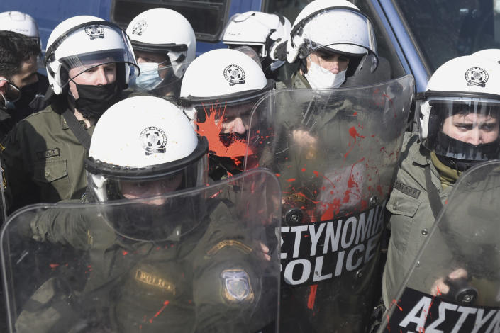 Police clash with protesters at the University of Thessaloniki in northern Greece, on Monday, Feb. 22, 2021. Police clashed with protesters and detained more than 30 people in Greece's second-largest city Monday during a demonstration against a new campus security law. (AP Photo/Giannis Papanikos)