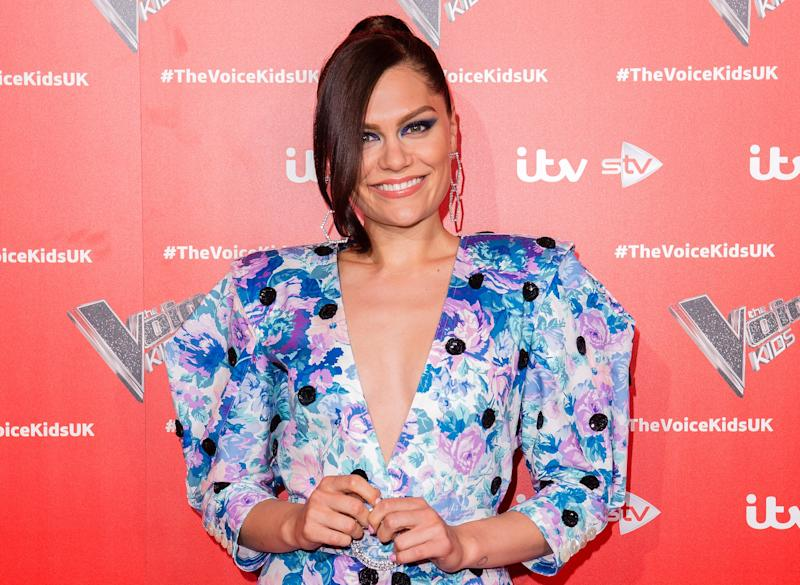 Jessie J looks adorable in multi-colored dress, and she looks like a damsel.