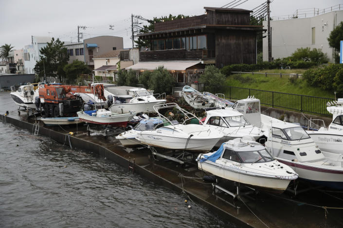 Boats are removed from the water in preparation for Typhoon Hagibis in Kamakura, west of Tokyo, Friday, Oct. 11, 2019. A typhoon was forecast to bring 2 feet of rain and damaging winds to the Tokyo area and central Japan's Pacific coast this weekend, and the government warned people Friday to stockpile and leave high-risk places before it's too dangerous. (AP Photo/Jae C. Hong)