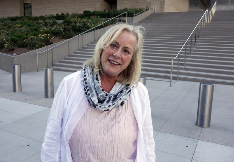 FILE - In this Aug. 29, 2017, file photo, Gail Steinbeck, widow of Thomas Steinbeck, the son of author John Steinbeck, leaves federal court in downtown Los Angeles. A federal appeals court has thrown out $8 million in punitive damages against the daughter-in-law of author John Steinbeck in her long-running copyright spat with the late author's step-daughter. The 9th U.S. Circuit Court of Appeals on Monday, Sept. 9, 2019, upheld a $5 million verdict against Gail Steinbeck and told her it's time to end her legal saga. (AP Photo/Brian Melley, File)