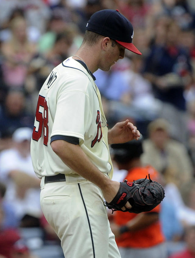 Atlanta Braves pitcher Alex Wood walks back to the plate after loading the bases with Miami Marlins during the third inning of a baseball game on Sunday, Sept. 1, 2013, in Atlanta. (AP Photo/John Amis)