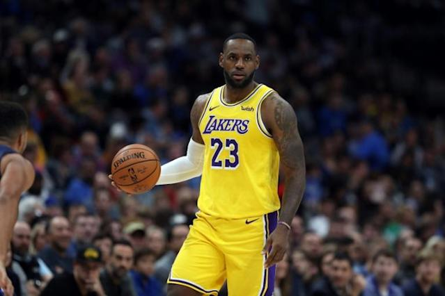 Los Angeles Lakers LeBron James says teams make the mistake of underestimating his defensive skills (AFP Photo/RONALD MARTINEZ)