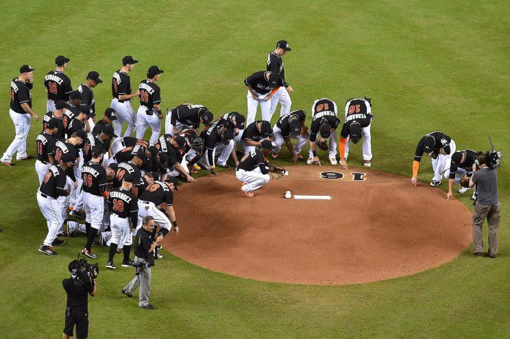 Members of the Miami Marlins gather around the mound to honor fallen teammate starting pitcher Jose Fernandez prior to the game against the New York Mets at Marlins Park. Mandatory Credit: Jasen Vinlove-USA TODAY Sports