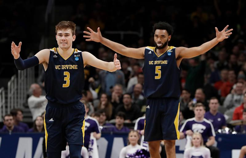 UC Irvine guard Robert Cartwright (3) and forward Jonathan Galloway (5) celebrate against Kansas State during the second half of a first round men's college basketball game in the NCAA Tournament Friday, March 22, 2019, in San Jose, Calif. (AP Photo/Chris Carlson)