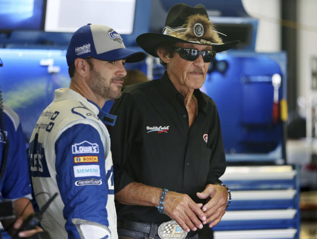 FILE - In this July 29, 2016, file photo, racing legend Richard Petty, right, stands with Jimmie Johnson (48) in the garage area of Pocono Raceway during practice for the NASCAR Sprint Cup Series Pennsylvania 400 auto race in Long Pond, Pa. Seven-time NASCAR champion Jimmie Johnson says 2020 will be his final season of full-time racing. The winningest driver of his era will have a 19th season in the No. 48 Chevrolet and once again chase a record eighth championship. Johnson made the announcement in a video posted on social media, Wednesday, Nov. 20, 2019. (AP Photo/Mel Evans, File)