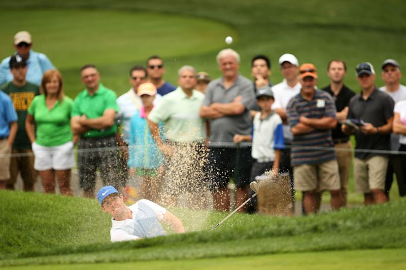 Rory McIlroy of Northern Ireland plays his third shot on the third hole during the third round of The Barclays at The Ridgewood Country Club on August 23, 2014 in Paramus, New Jersey (AFP Photo/Darren Carroll)