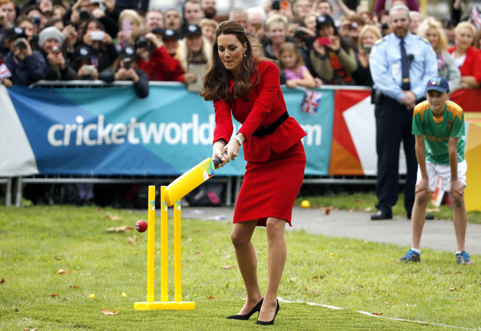 Catherine, the Duchess of Cambridge, tries to hit a ball using a cricket bat as she and her husband, Britain's Prince William, attend a promotional event for the upcoming Cricket World Cup in Christchurch April 14, 2014. The Prince and his wife Kate are undertaking a 19-day official visit to New Zealand and Australia with their son George.    REUTERS/Phil Noble  (NEW ZEALAND - Tags: ROYALS ENTERTAINMENT POLITICS TPX IMAGES OF THE DAY)