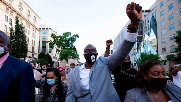 PHOTO: Philonise Floyd, a brother of George Floyd march with others on Black Lives Matter Plaza street near the White House, to protest police brutality and racism, June 10, 2020 in Washington, DC. (Jose Luis Magana/AFP via Getty Images)