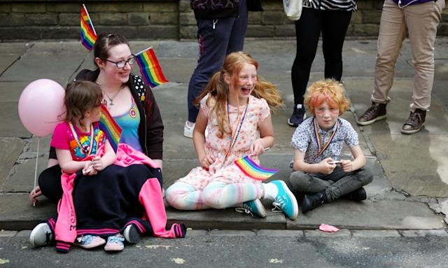 <p>A family sit on the side of the road watching the York Pride parade on June 9, 2018 in York, England. The parade made its way through the streets of the city centre before reaching the Knavesmire area of the city where live entertainment was performed for the crowds. (Photo: Ian Forsyth/Getty Images) </p>