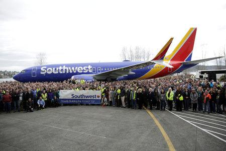 Boeing employees pose in front of a 737 MAX 8 produced for Southwest Airlines as Boeing celebrates the 10,000th 737 to come off the production line in Renton, Washington, U.S., March 13, 2018.  REUTERS/Jason Redmond