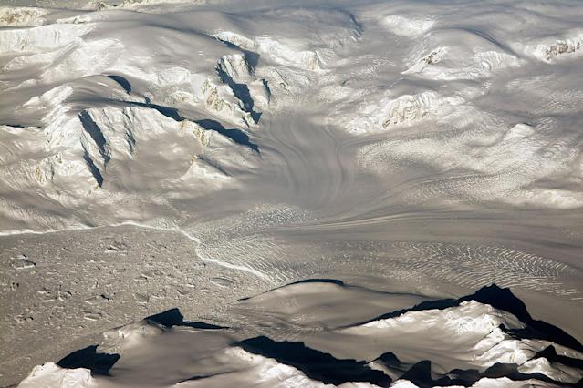 <p>Glaciers and mountains in the evening sun are seen on an Operation IceBridge research flight, returning from West Antarctica on Oct. 29, 2014. NASA is carrying out research flights over Antarctica to study changes in the continent's ice sheet, glaciers and sea ice. The Antarctic Peninsula has been warming faster than the rest of the continent. (Photo: NASA/Michael Studinger) </p>