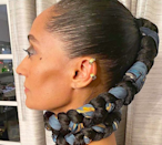 """One of the biggest trends for 2020? """"Adding materials like beads, fabric, or jewelry to your braids or faux locs,"""" says <a href=""""https://www.instagram.com/iamaraxilindsey/"""" rel=""""nofollow noopener"""" target=""""_blank"""" data-ylk=""""slk:Araxi Lindsey"""" class=""""link rapid-noclick-resp"""">Araxi Lindsey</a>, the stylist behind all the stunning natural hair looks on <em>Black-Ish.</em> Here she's re-created a basic three-strand braid that's anything but."""