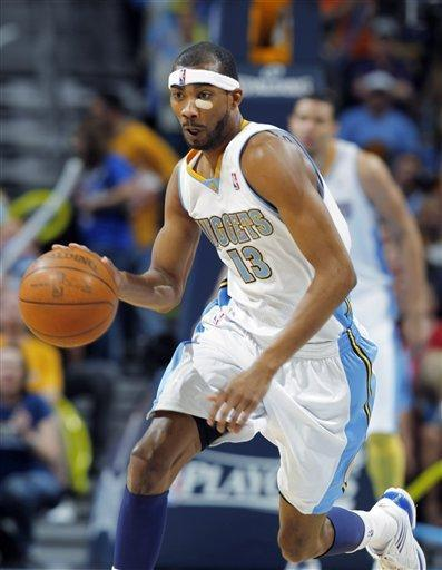 Denver Nuggets forward Corey Brewer picks up a loose ball and heads down the court against the Los Angeles Lakers in the fourth quarter of the Nuggets' 113-96 victory in Game 6 of the teams' first-round NBA basketball series in Denver on Thursday, May 10, 2012. (AP Photo/David Zalubowski)