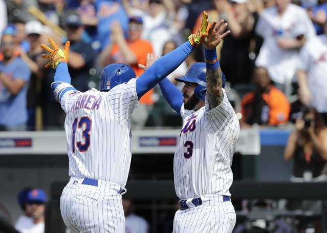 New York Mets' Tomas Nido (3) celebrates with teammate Asdrubal Cabrera (13) after they scored on a home run by Cabrera during the seventh inning of a baseball game against the Arizona Diamondbacks, Sunday, May 20, 2018, in New York. (AP Photo/Frank Franklin II)