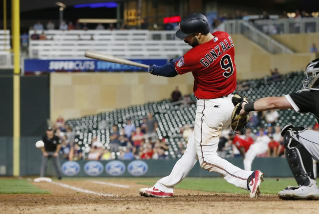 Minnesota Twins' Marwin Gonzalez hits a two-run single off Chicago White Sox. Pitcher Jose Ruiz to tie the score during the 12th inning of a baseball game Tuesday, Sept. 17, 2019, in Minneapolis. The Twins won 9-8 when Ronald Torreyes was hit by a Ruiz pitch in the 12th with the bases loaded. (AP Photo/Jim Mone)