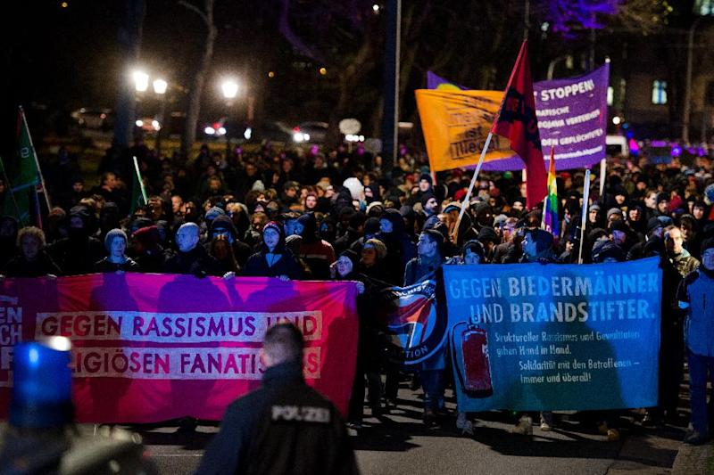 """Demonstrators protest against the PEGIDA movement, or """"Patriotic Europeans Against the Islamification of the Occident,"""" at a rally on December 8, 2014 in Dresden, Germany (AFP Photo/Arno Burgi)"""