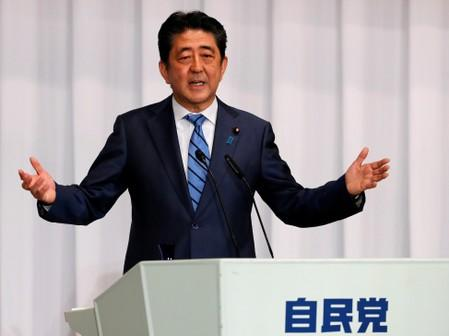 Japan PM Abe's coalition on track to win solid majority in election: media