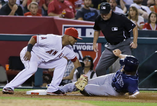 Tampa Bay Rays' Wil Myers is tagged out at third by Los Angeles Angels third baseman Luis Jimenez, trying to advance on a Jose Lobaton single that scored a run in the fourth inning of a baseball game in Anaheim, Calif., Tuesday, Sept. 3, 2013. (AP Photo/Reed Saxon)