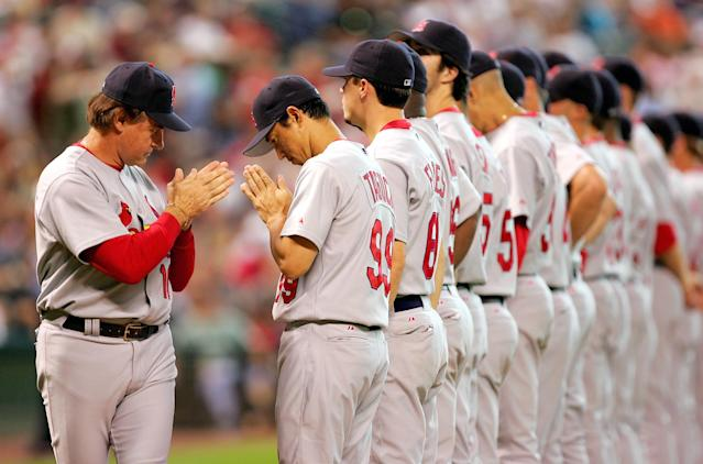 HOUSTON - OCTOBER 16: Manager Tony LaRussa #10 of the St. Louis Cardinals bows to player So Taguchi #99 before game three of National League Championship Series against the Houston Astros during the 2004 Major League Baseball Playoffs on October 16, 2004 at Minute Maid Park in Houston, Texas. (Photo By Jamie Squire/Getty Images)