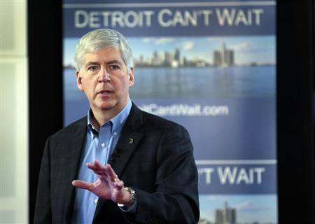 Michigan Governor Rick Snyder talks about the city of Detroit being in a financial emergency state during a meeting with an invited audience at Wayne State University in Detroit,