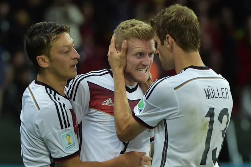 Germany's forward Andre Schuerrle celebrates with his teammates after scoring against Algeria at Beira-Rio Stadium in Porto Alegre on June 30, 2014