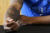 """Duke forward Paolo Banchero shows his """"Know Pressure"""" tattoo as he speaks to reporters during the team's NCAA college basketball media day in Durham, N.C., Tuesday, Sept. 28, 2021. (AP Photo/Gerry Broome)"""