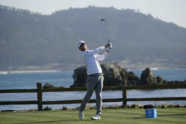 Nick Taylor, of Canada, follows his drive from the 18th tee of the Pebble Beach Golf Links during the final round of the AT&T Pebble Beach National Pro-Am golf tournament Sunday, Feb. 9, 2020, in Pebble Beach, Calif. (AP Photo/Eric Risberg)