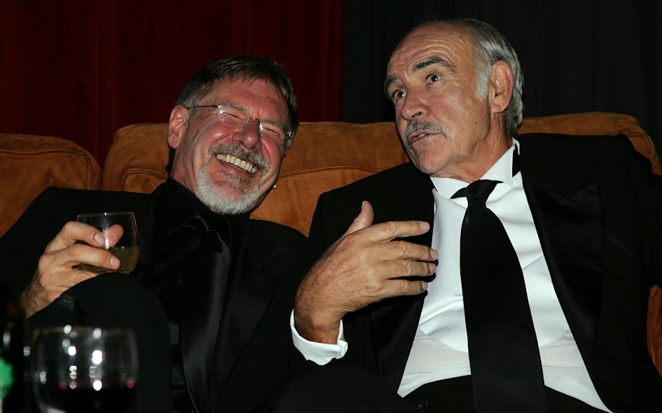 HOLLYWOOD, CA - JUNE 08:  Actors Sean Connery and Harrison Ford attend the after party for the 34th AFI Life Achievement Award tribute to Sir Sean Connery held at the Kodak Theatre on June 8, 2006 in Hollywood, California.  (Photo by Mark Mainz/Getty Images for AFI)