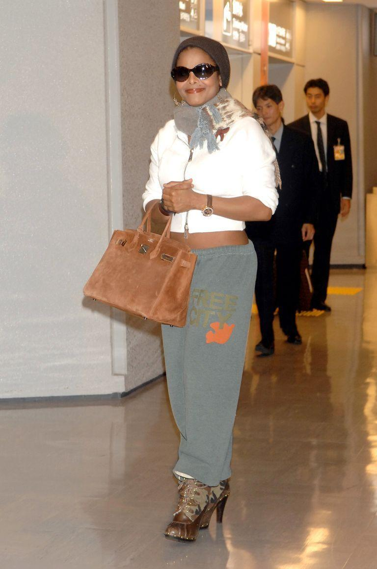 <p>Janet Jackson wears sweatpants with high heel boots as she makes her way through the airport in Narita, Japan in October 2006. </p>