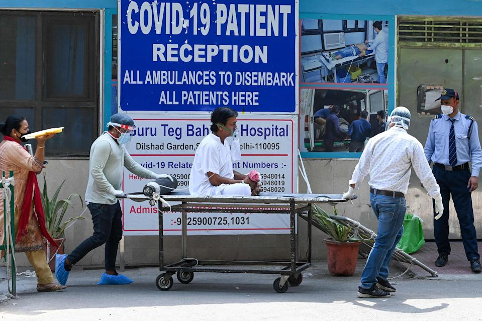 A patient is shifted to ward after admission at GTB hospital in New DelhiAFP/Getty