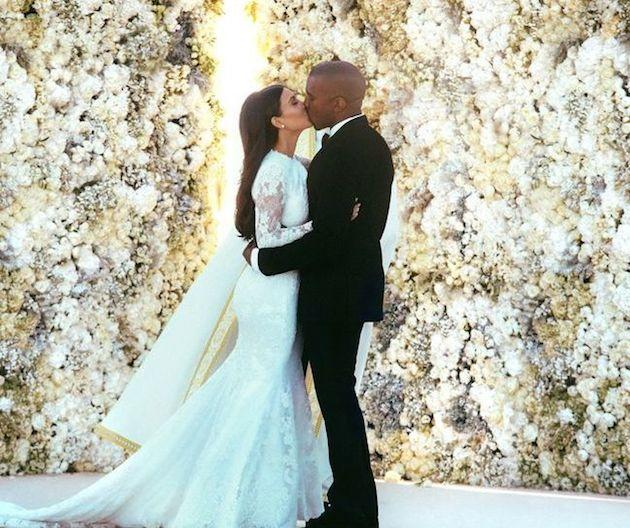 <p>Although the duo may not be everyone's cup of tea you can't deny their wedding was spectacular. Their wall of white flowers certainly is a wedding touch lots of us want to steal.<i> [Photo: Kim Kardashian/ Instagram]</i></p>