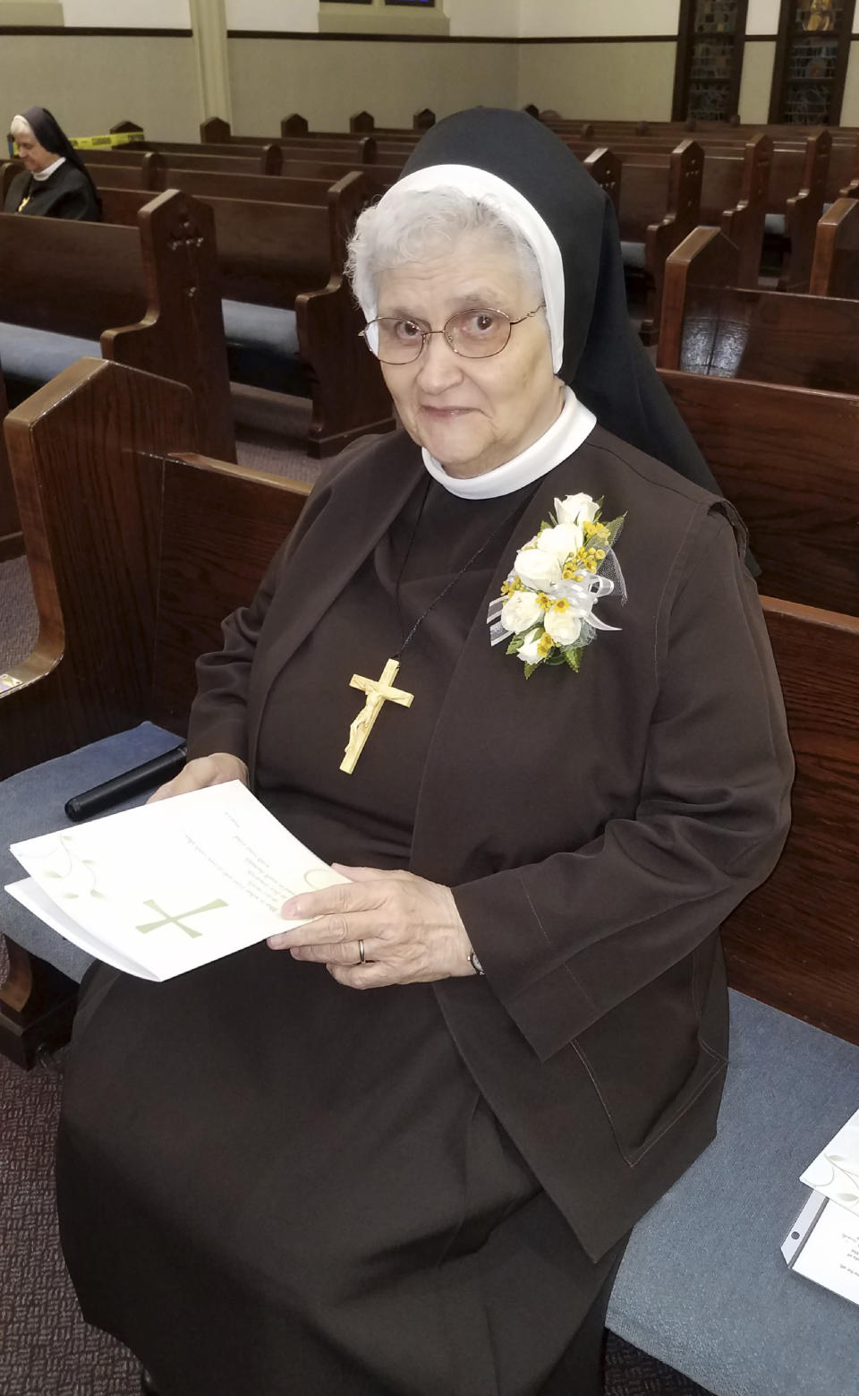 In this photo provided by Sister Mary Jeanine Morozowich, Sister Mary Evelyn Labik is recognized for her 60 years with the Felician Sisters of North America, in Greensburg, Pa., on Oct. 4, 2020. Labik contracted the coronavirus soon after and died. (Sister Mary Jeanine Morozowich via AP)