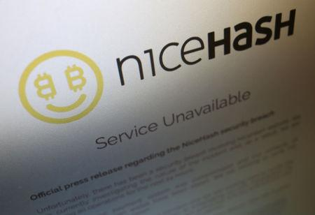 A notice announcing that service is unavailable is displayed on the website of Slovenian cryptocurrency mining firm NiceHash, which said it had suffered a hack of its Bitcoin wallet, in photo illustration December 7, 2017. REUTERS/Chris Helgren