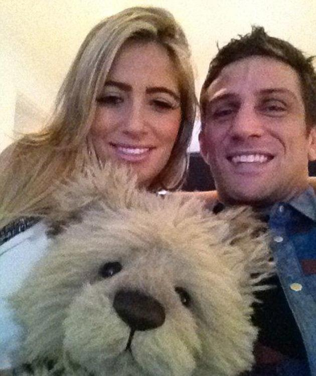 Parents-to-be Chantelle Houghton and Alex Reid cuddled up to a teddy.