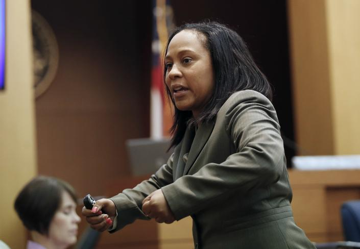 FILE - In this Wednesday, Aug. 24, 2016, file photo, Fulton County Deputy District Attorney Fani Willis makes her closing arguments during a trial in Atlanta. Willis, entered the national spotlight Wednesday, Feb. 10, 2021, when letters to top state officials revealed her office is investigating whether illegal attempts were made to influence the state's 2020 elections. (AP Photo/John Bazemore, File)