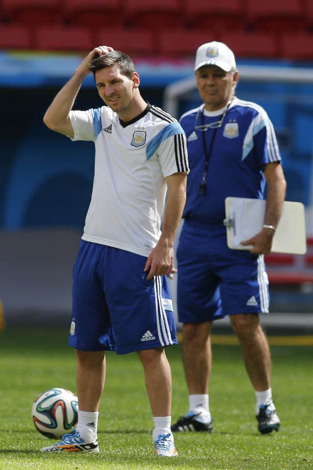 Argentina's Lionel Messi, left, stands next to Argentina's head coach Alejandro Sabella, right, during a training session at Estadio Nacional in Brasilia, Brazil, Friday, July 4, 2014. On Saturday, Argentina will face Belgium in their World Cup quarterfinals soccer match. (AP Photo/Victor R. Caivano)