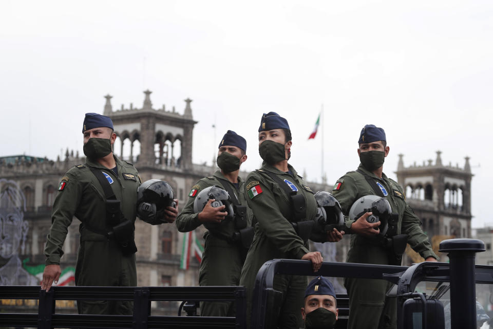 Airforce pilots wearing masks to curb the spread of the new coronavirus participate in the annual Independence Day military parade in Mexico City's main square of the capital, the Zócalo, Wednesday, Sept. 16, 2020. Mexico celebrates the anniversary of its independence uprising of 1810. ( AP Photo/Marco Ugarte)