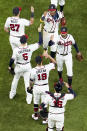 The Atlanta Braves celebrate their win against the Los Angeles Dodgers in Game 4 of a baseball National League Championship Series Thursday, Oct. 15, 2020, in Arlington, Texas. (AP Photo/David J. Phillip)