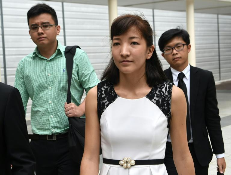 """Australian Japanese Ai Takagi (front) and her Singaporean husband Yang Kaiheng (left), each face 7 sedition charges for articles published between October 2013 and February 2015 on the socio-political website """"The Real Singapore"""""""