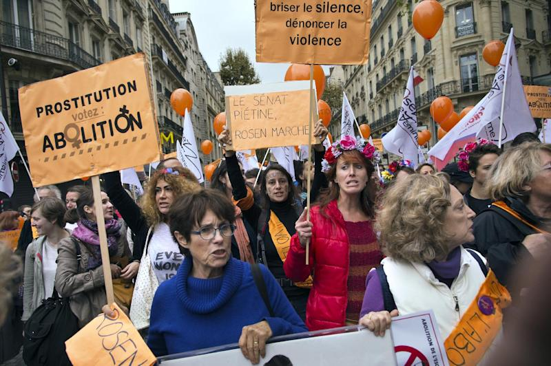 People take part in a demonstration lead by former French prostitute Rosen Hicher (unseen), an activist for the abolition of prostitution, on October 12, 2014, near the Senate in Paris (AFP Photo/Lionel Bonaventure)