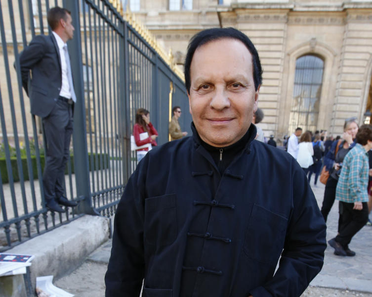 <p> FILE - A Friday, Sept. 26, 2014 file photo of Tunisian-born fashion designer Azzedine Alaia arriving at Christian Dior's Spring/Summer 2015 ready-to-wear fashion collection presented in Paris, France. Alaia, an iconoclast whose clingy dresses marked the 1980s and who dressed famous women from Hollywood to the White House, has died at age 77. The French Haute Couture Federation announced Alaia's death on Saturday, Nov. 18, 2017, without providing details. (AP Photo/Francois Mori, File) </p>