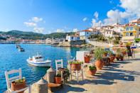 """<p>If you have money to invest, <a href=""""https://www.cntraveler.com/story/how-the-greek-islands-became-one-of-the-worlds-biggest-tourist-destinations?mbid=synd_yahoo_rss"""" rel=""""nofollow noopener"""" target=""""_blank"""" data-ylk=""""slk:Greece"""" class=""""link rapid-noclick-resp"""">Greece</a> may be the retirement spot for you. Since 2013, this European country has offered its <a href=""""https://www.goldenvisas.com/citizenship-by-investment-greece"""" rel=""""nofollow noopener"""" target=""""_blank"""" data-ylk=""""slk:Greece Golden Visa"""" class=""""link rapid-noclick-resp"""">Greece Golden Visa</a>, granting five-year permanent residency to anyone investing approximately $301,892 or more in local real estate. After five years you can then renew your residency (as long as you're still invested in local property), and you can apply for citizenship after seven.</p> <p>To make things more enticing, Greece's Ministry of Finance recently proposed a <a href=""""https://www.propertywire.com/greeces-enticing-7-tax-rate-for-retirees/"""" rel=""""nofollow noopener"""" target=""""_blank"""" data-ylk=""""slk:seven-percent flat tax"""" class=""""link rapid-noclick-resp"""">seven-percent flat tax</a> for any foreign nationals willing to transfer their tax residence (meaning the place where you're legally required to pay taxes) here. This means that any pensions, rental income, and other transferable investments will stay at a seven-percent tax rate for up to 10 years. With tax brackets in the U.S. <a href=""""https://taxfoundation.org/the-three-basic-tax-types/"""" rel=""""nofollow noopener"""" target=""""_blank"""" data-ylk=""""slk:typically ranging from 10 to 37 percent"""" class=""""link rapid-noclick-resp"""">typically ranging from 10 to 37 percent</a>, it's a steal.</p> <p><strong>Requirements:</strong> There's no requirement to invest in local real estate to take advantage of the tax rate, nor are you expected to permanently reside in Greece. Still, the overall goal is to bring in foreign dollars, so government officials hope you'll spend accordingly. Anyone interested in util"""